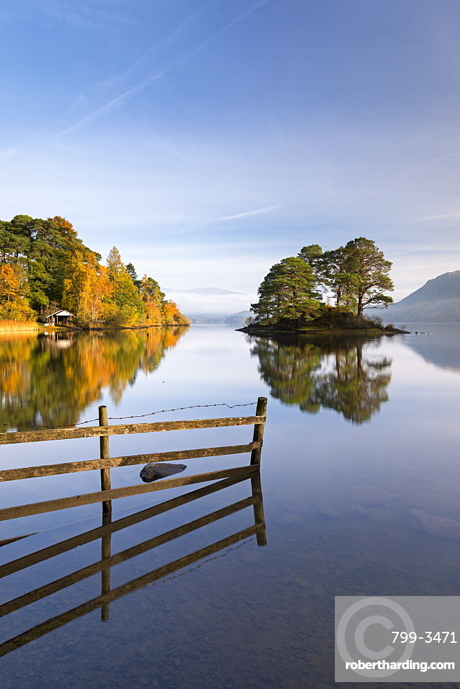 Mirror still tranquil morning on Derwent Water in the Lake District, Cumbria, England, United Kingdom, Europe