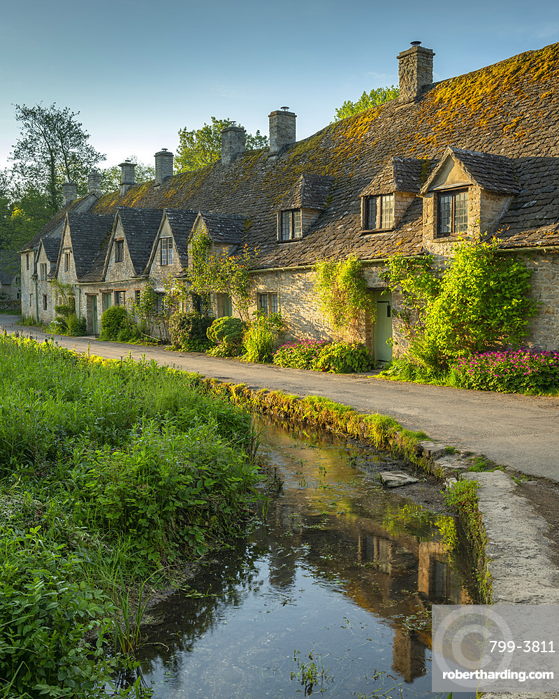 Arlington Row cottages in the pretty Cotswold village of Bibury, Gloucestershire, England. Spring (May) 2019.