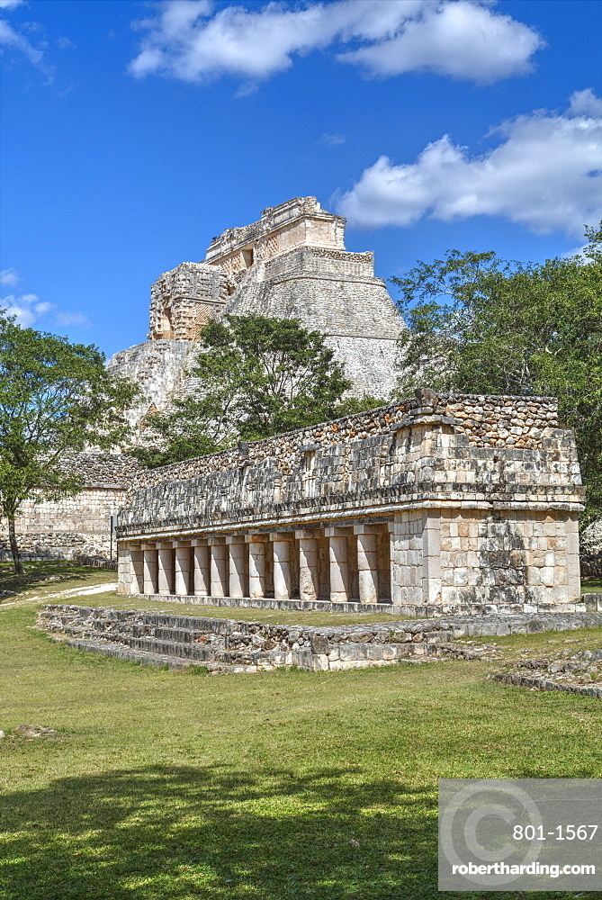 Columns Building in foreground with Pyramid of the Magician beyond, Uxmal, Mayan archaeological site, UNESCO World Heritage Site, Yucatan, Mexico, North America