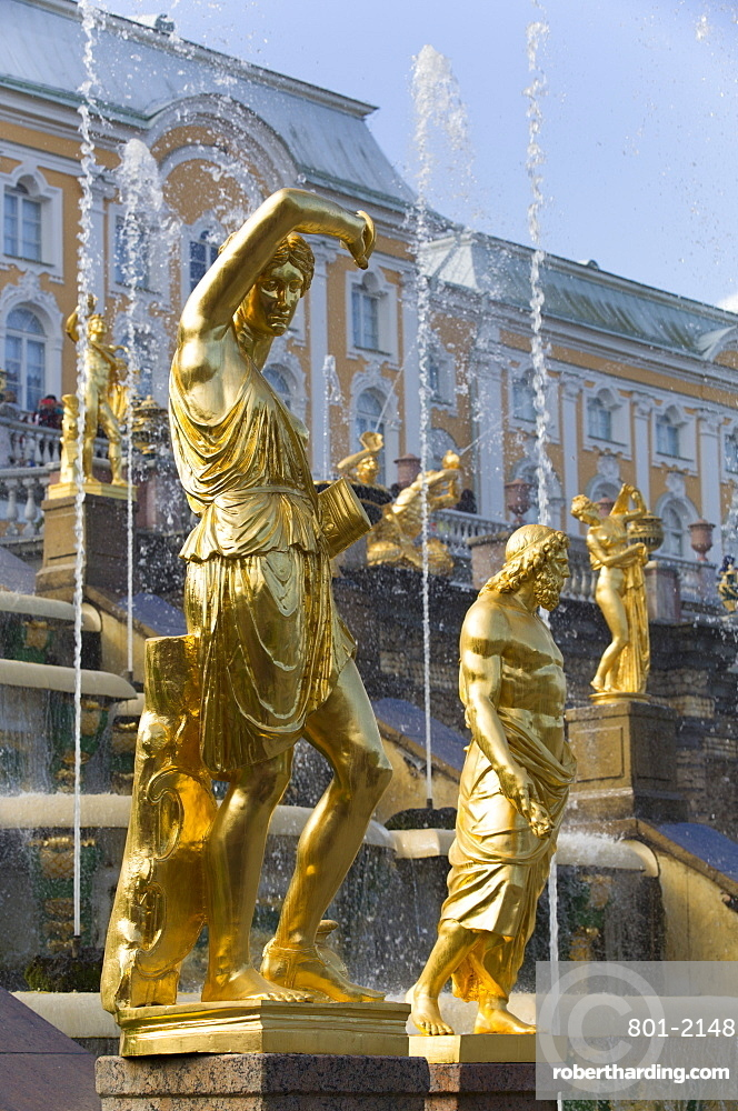 Statue of Jupiter to left in foreground, Great Cascade in the background, Peterhof, UNESCO World Heritage Site, near St. Petersburg, Russia, Europe