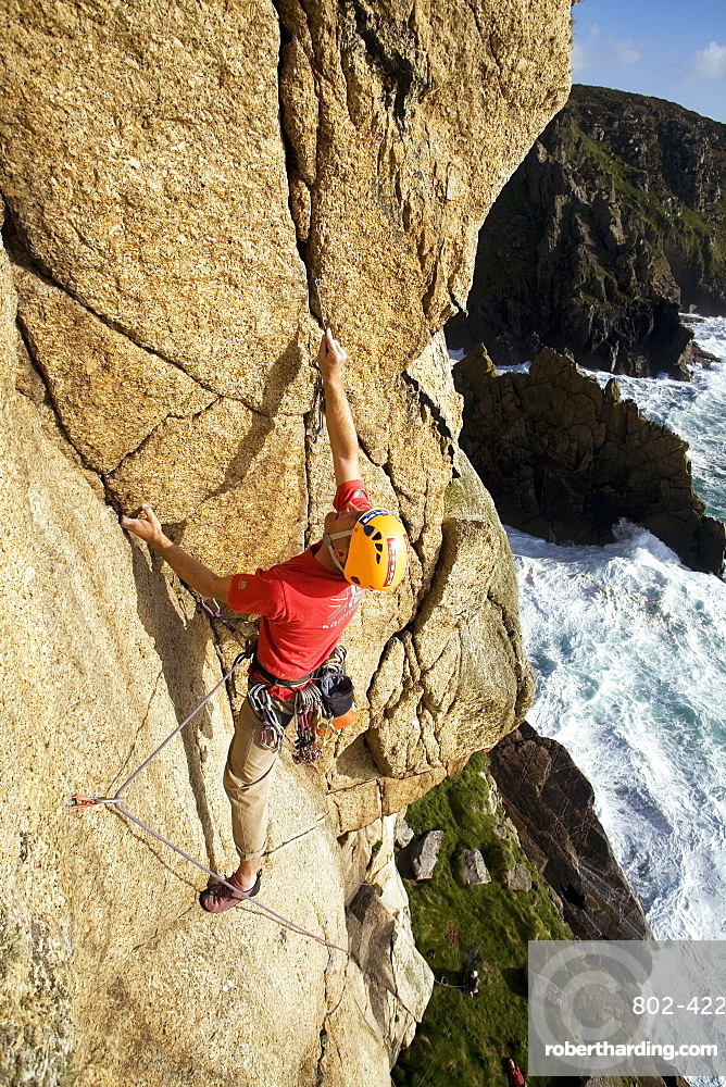 Rock climber in action at Bosigran, Cornwall, England, United Kingdom, Europe