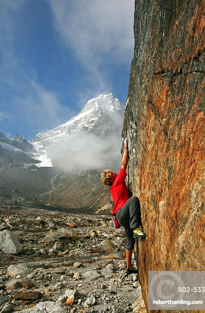 Climber bouldering at Tangnag moraine, Khumbu, Himalayas, Nepal, Asia