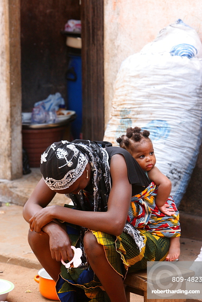 African woman carrying her baby | Stock Photo