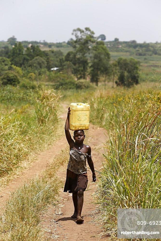 Ugandan child fetching water, Masindi, Uganda, Africa