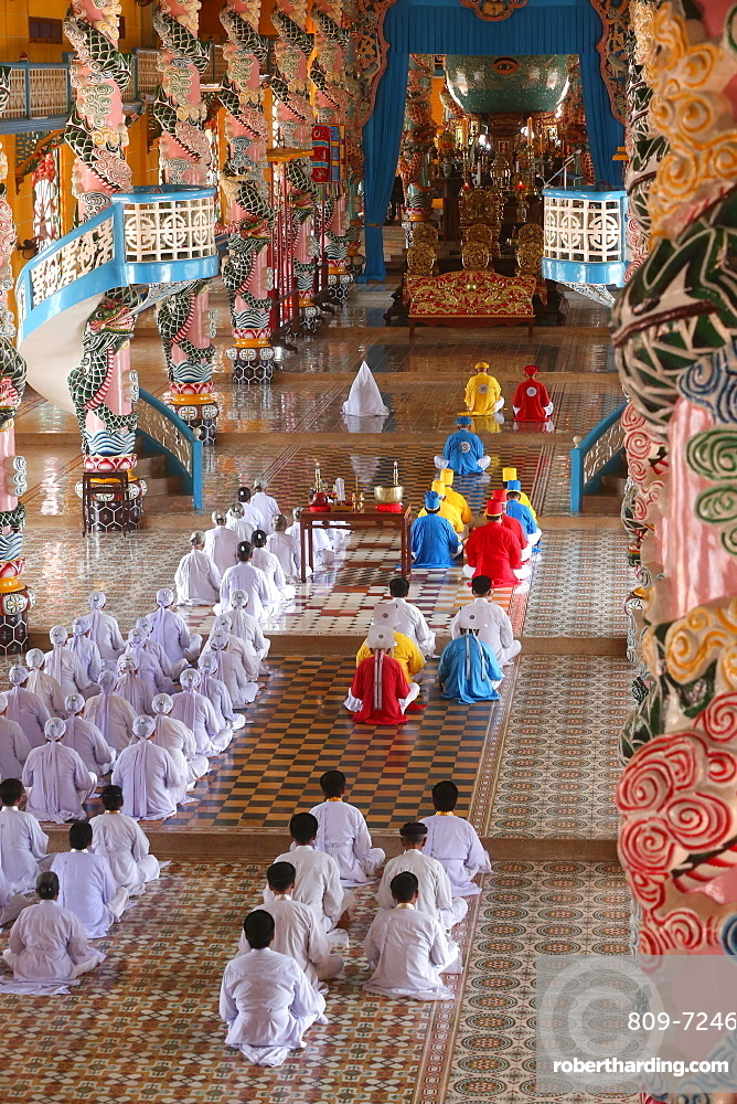 Cao Dai Holy See Temple. Caodaist service with priests. Thay Ninh. Vietnam.