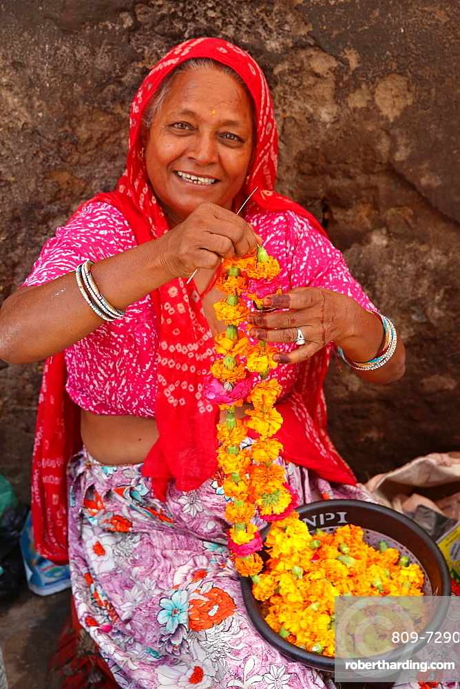 Indian woman making garlands in Ajmer, India.