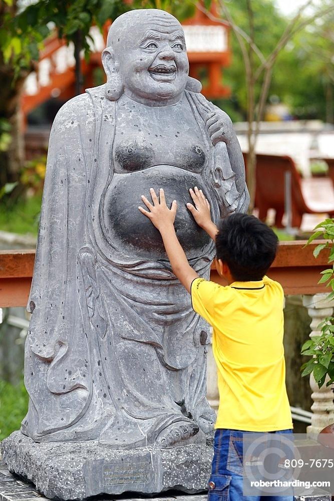 Truc Lam Phuong Nam Buddhist temple, small boy touching Angada statue, Can Tho, Vietnam, Indochina, Southeast Asia, Asia
