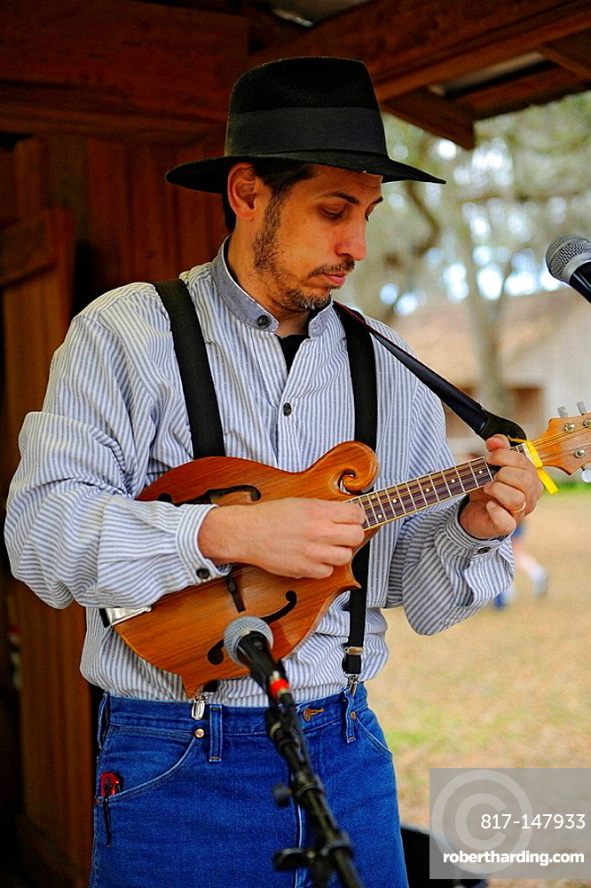 Guitar Player Performs with Pleasant Family Country Band at Cracker Country Florida living history museum located on the Florida State Fairgrounds, Tampa