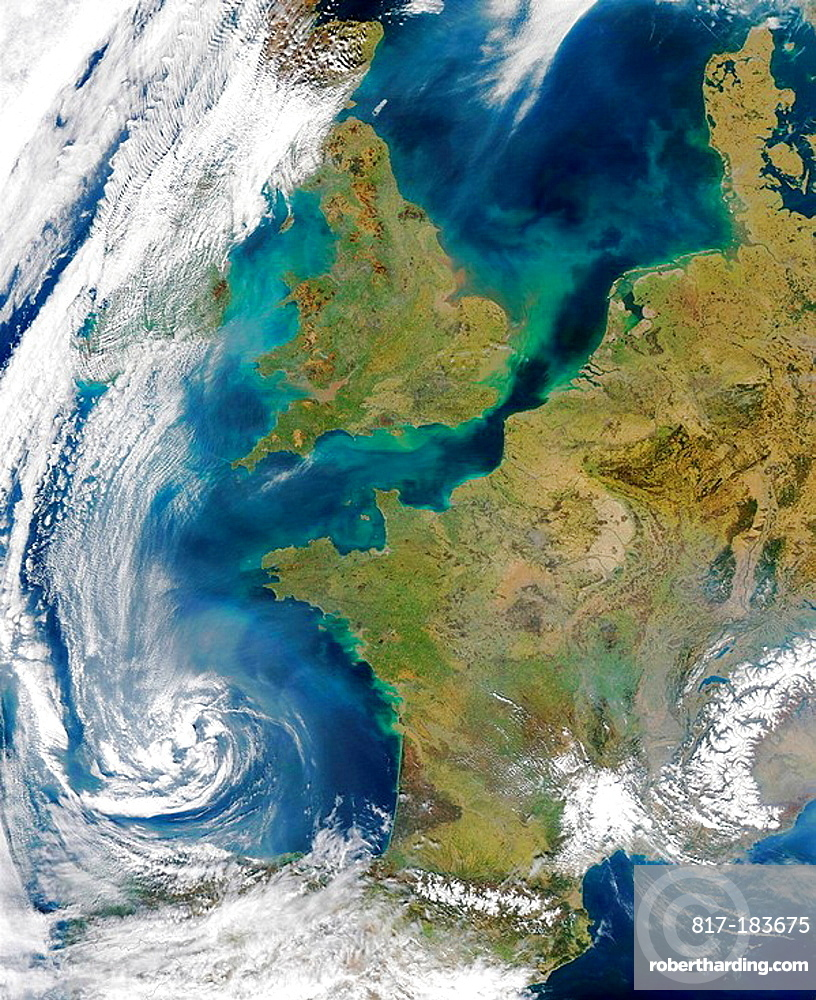 Pollution and smoke get caught up in a swirl of clouds off on the coasts of Spain bottom center), France (center), the United Kingdom (top center), and Ireland (under cloud at top left) in this true-color Aqua MODIS image acquired on March 22, 2003
