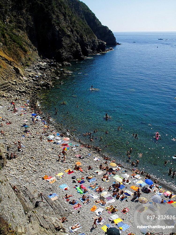 Sunbathers On The Beach At Riomaggiore In Cinque Terre Region Of Italian Riviera Or