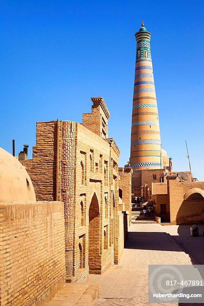 Pahlavan Mahmud Mausoleum on left and Islam Khodja Minaret, Ichan Kala, Khiva, Uzbekistan.