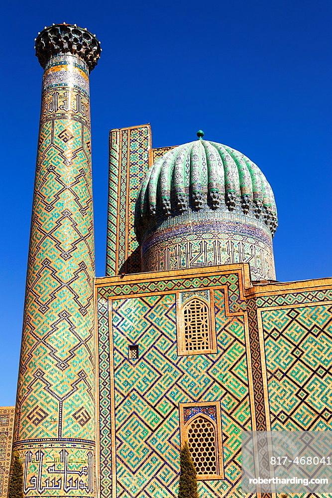 A minaret and dome of Sher Dor Madrasah, also known as Shir Dor Madrasah, Registan Square, Samarkand, Uzbekistan.