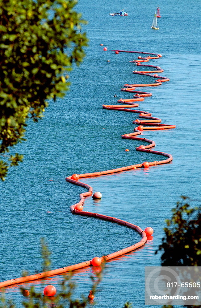Floating barrier to stop pollution from the fuel spilled by the Prestige Tanker ecological disaster, Bahia de Santander, Cantabria, Spain