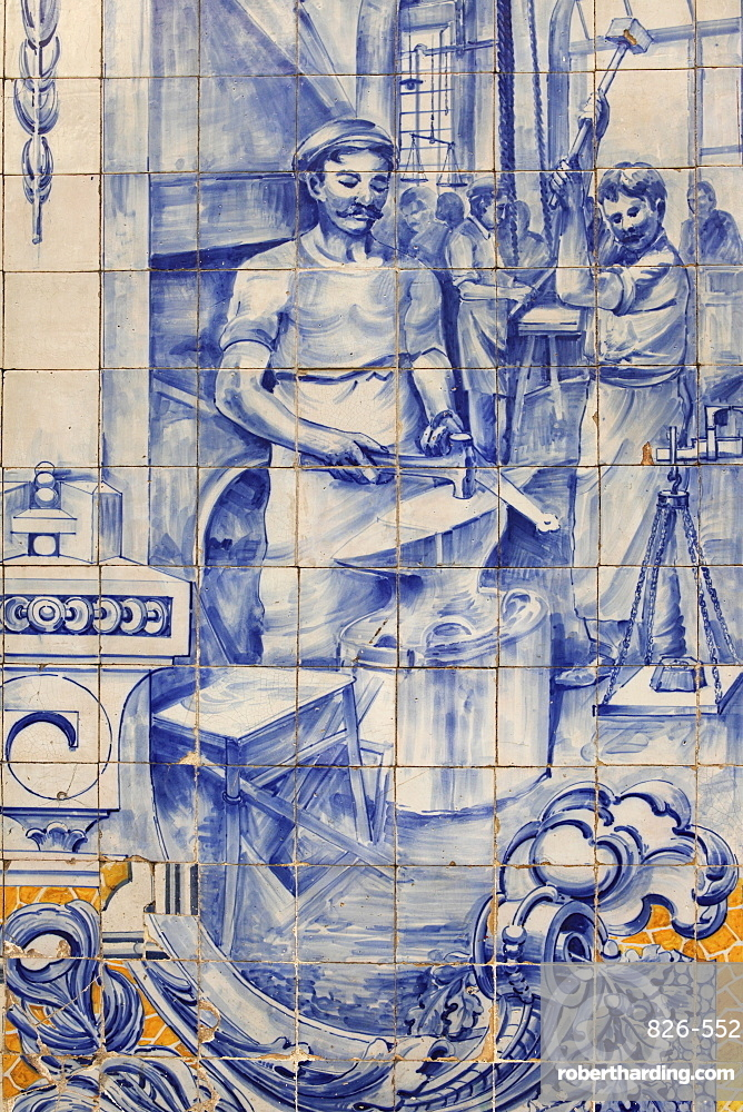A blacksmith's workshop depicted on traditional Portuguese Azulejo tiles on a building in Alfama, Lisbon, Portugal, Europe