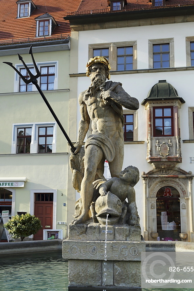 The Neptune Fountain on the cobbled Market Place (Marktplatz) in Weimar, Thuringia, Germany, Europe