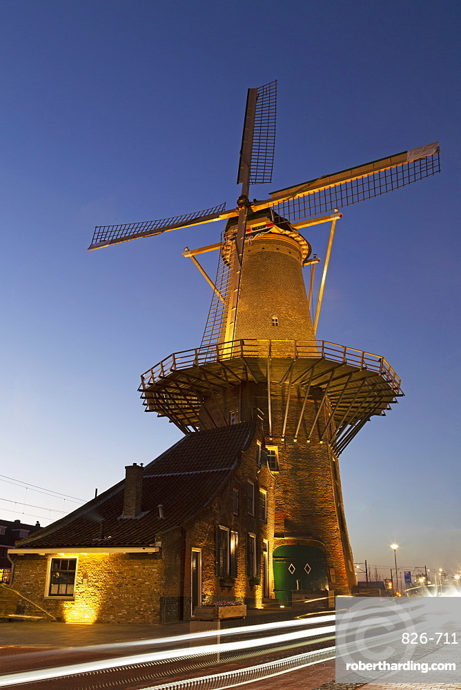 Light streaks by the Molen de Roos, a windmill in Delft, South Holland, The Netherlands, Europe