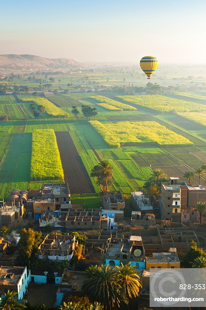 Ballooning over village near the Valley of the Kings, Thebes, Upper Egypt, Egypt, North Africa, Africa