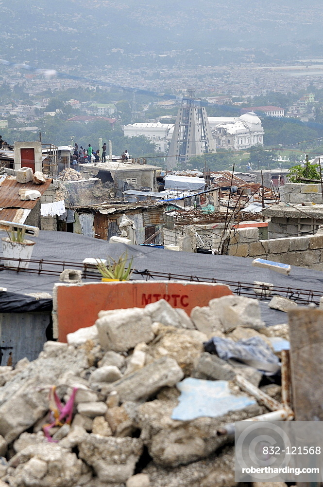 Rubble in the slums of Fort National, the district was largely destroyed by the earthquake in January 2010, in the back the destroyed presidential palace, Port-au-Prince, Haiti, Caribbean, Central America