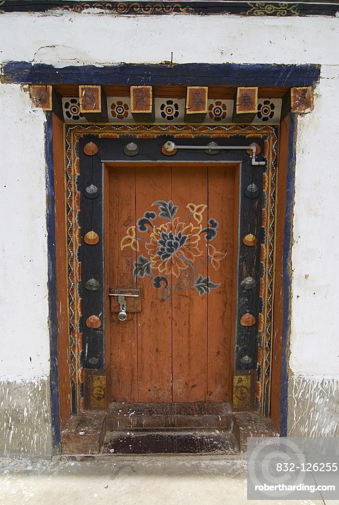 Painted door, Chimi Lhakhang monastery, Bhutan, Asia