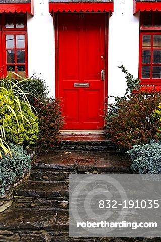 Stone stairs, red door, Kenmare, Ireland, Europe