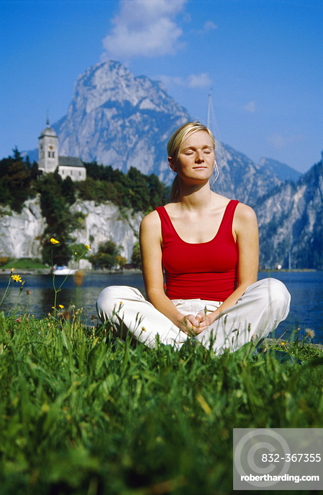 Blonde woman relaxing at the Traunsee Lake, Traunkirchen, Upper Austria, Europe