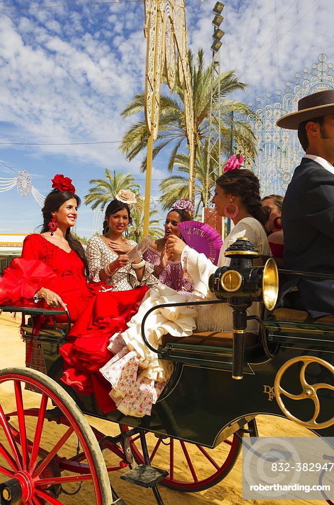 Young ladies wearing gypsy dresses at the Feria del Caballo Horse Fair, Jerez de la Frontera, Cadiz province, Andalusia, Spain, Europe