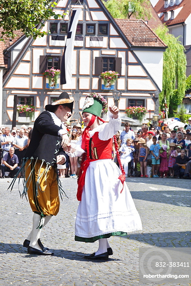 Farmer dancing with a peasant, Fischerstechen or water jousting festival, Ulm, Baden-Wurttemberg, Germany, Europe