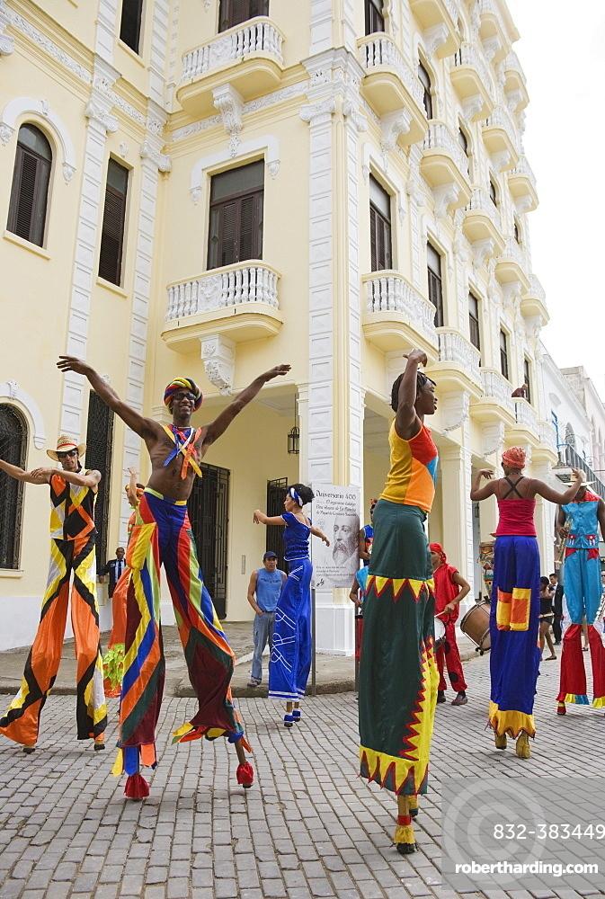 Street performers walking on stilts in Old Havana, Havana, Cuba, Central America
