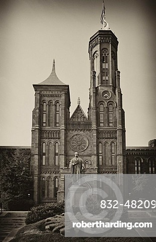 Black and white image, sepia, statue of the scientist Joseph Henry in front of the Smithsonian Institution Building, admin building and museum, commonly known as
