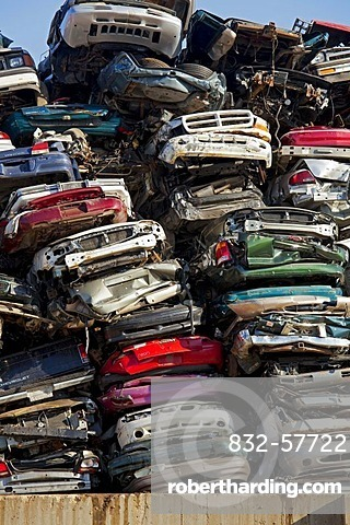 Junk cars crushed and ready for recycling at a scrap yard, Detroit, Michigan, USA