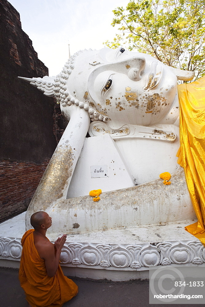 Monk in front of Reclining Buddha statue at Wat Yai Chai Mongkhon, Ayutthaya Historical Park, UNESCO World Heritage Site, Ayutthaya, Thailand, Southeast Asia, Asia