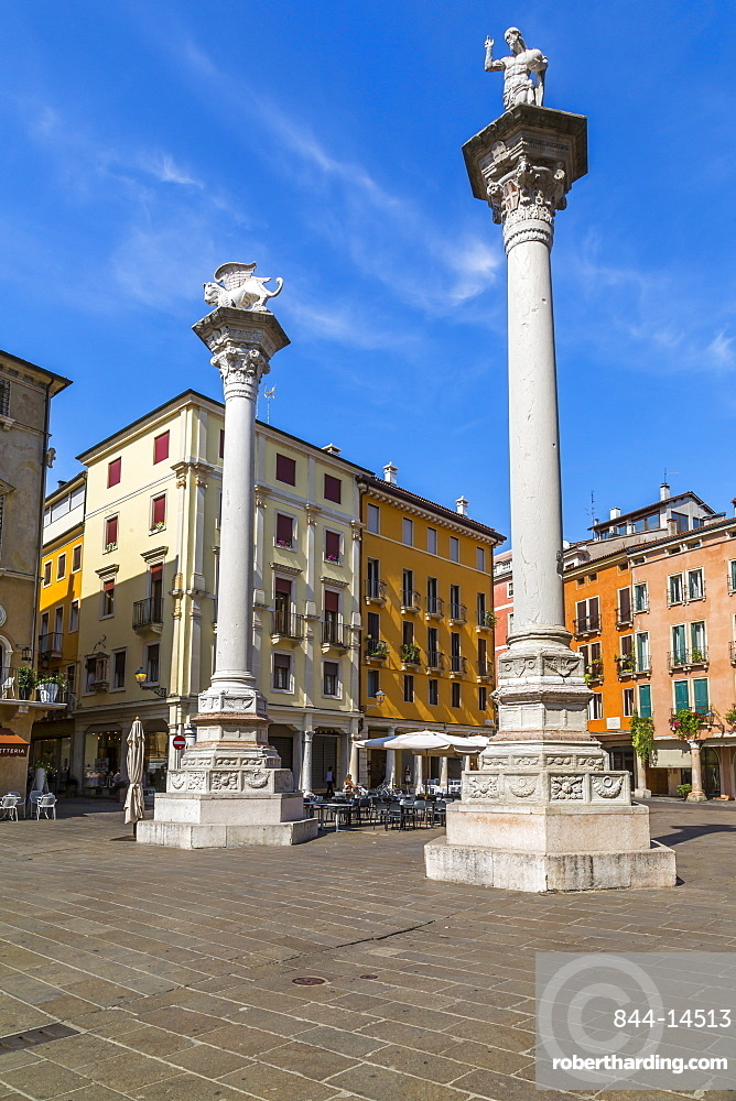 Two columns in Piazza dei Signori, one bearing the Venice Lion, the other with St. Theodore, Vicenza, Veneto, Italy, Europe