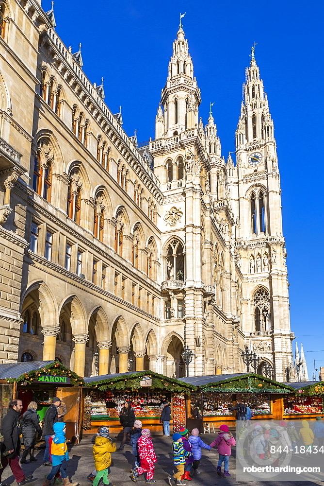 View of Rathaus and Christmas market stalls in Rathausplatz, Vienna, Austria, Europe
