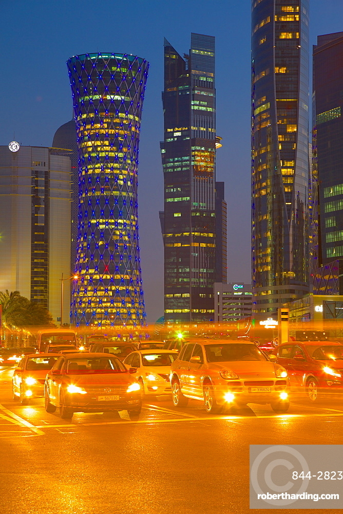 Contemporary architecture and traffic at dusk in the City Centre, Doha, Qatar, Middle East