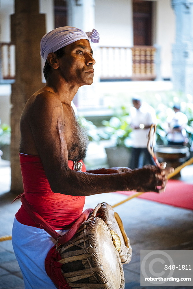 Drummer during Puja, Temple of the Sacred Tooth Relic, Kandy, Central Province, Sri Lanka, Asia