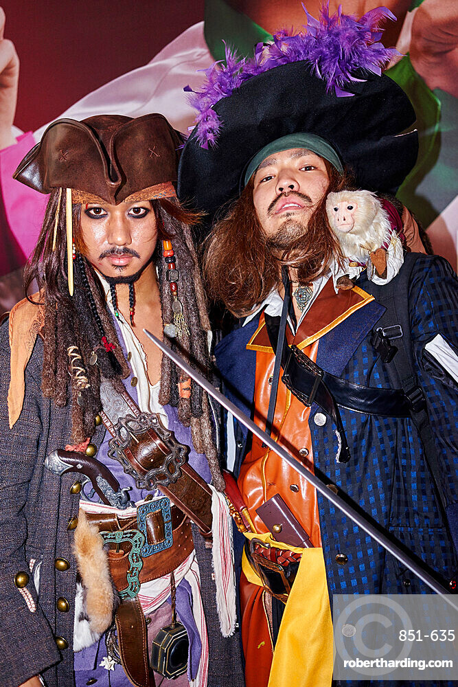 Japanese men dressed as Captain Jack Sparrow and Captain Barbossa from the Pirates of the Caribbean on Halloween in Shibuya