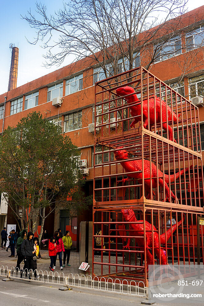 Red dinosaurs sculpture by Sui Jianguo in Dashanzi Art District, Beijing, China, Asia