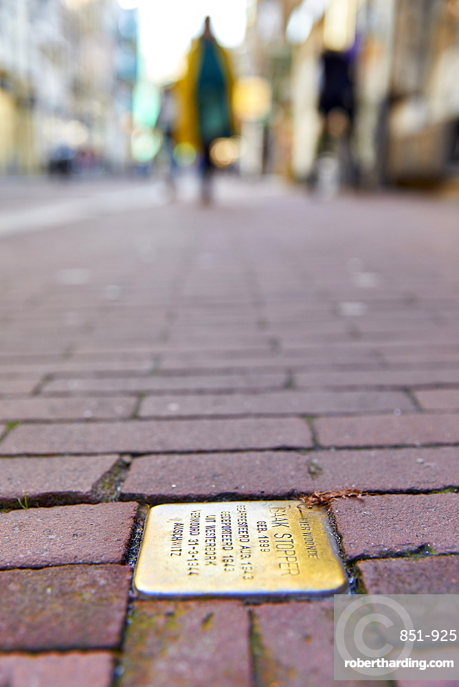 Stumbling Stones or Stolpersteine are Holocaust memorial plaques in front of the victims last home, Nieuwe Hoogstraat, Amsterdam