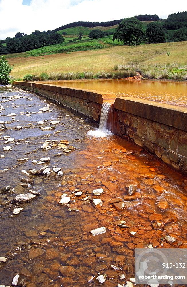 Iron oxide mine pollution, River Pelenna, Cwm Gwenffrwd, Tonmawr, Mid Glamorgan, Wales, Uk, Europe