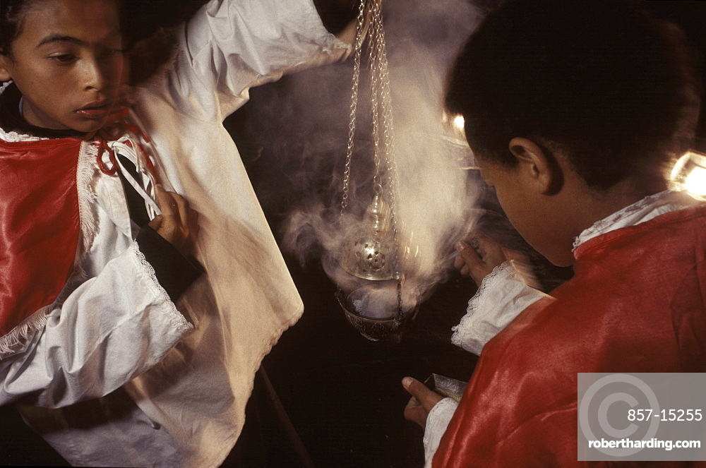 Two young altar boys fill a 200-year-old incensor for a reenactment of the washing of the apostles' feet by Jesus on Holy Thursday in Ouro Preto, a colonial Brazilian city noted for its baroque architecture.