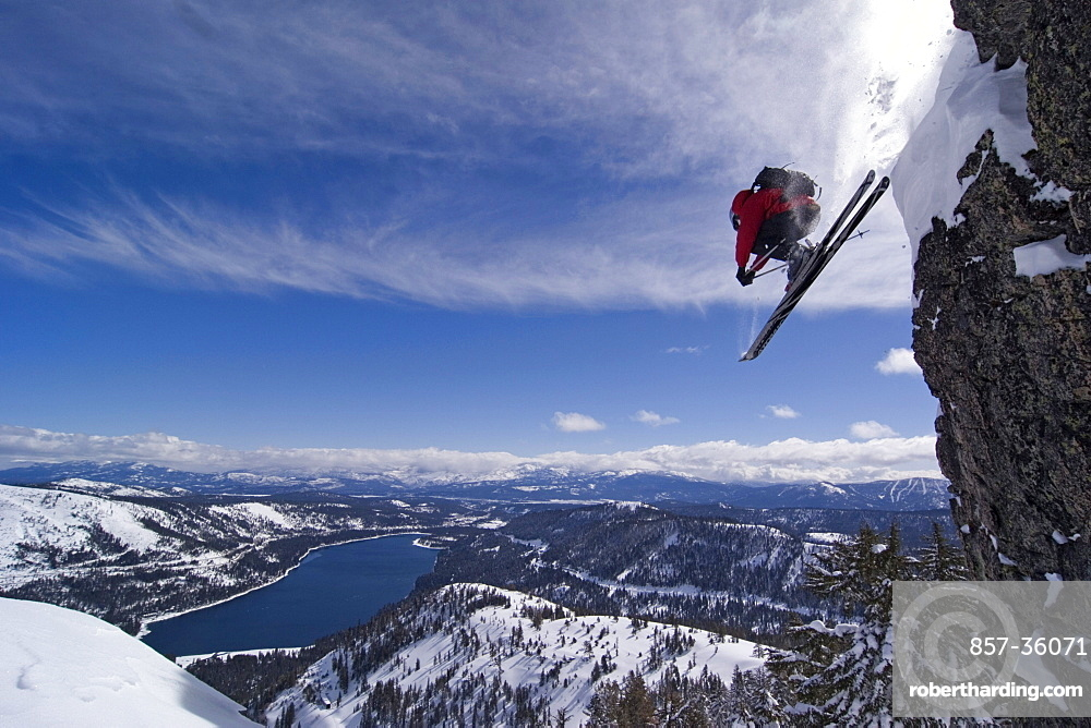 A man skiing off a cliff above Donner Lake California.