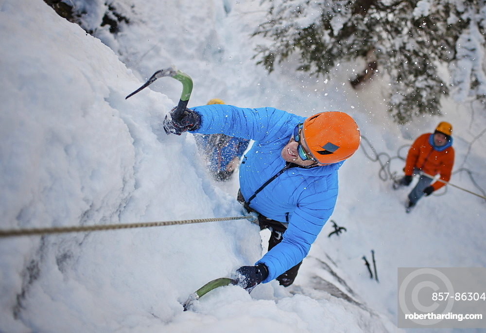 A man climbs a wall of ice in Whistler, British Columbia, Canada, Whistler, British Columbia, Canada