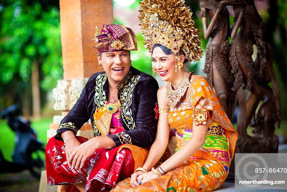 Couple enacting wedding scene in preparation for religious ceremony.Bali. Indonesia, Ubud, Bali Island, Indonesia
