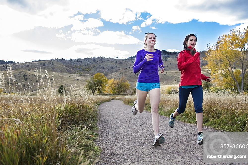 Females running outside together in the foothills of Boulder, Colorado, Boulder, Colorado, United States