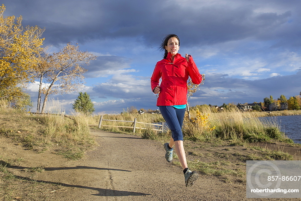 Female running outside in the foothills of Boulder, Colorado, Boulder, Colorado, United States