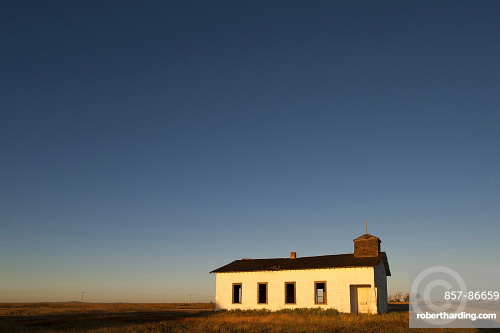 An abandoned church on the high plains of eastern New Mexico greets the morning light, New Mexico, USA