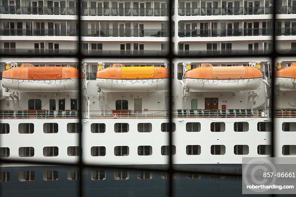 View of cruise ship life rafts through an old window in Oslo, Norway, Oslo, Oslo, Norway