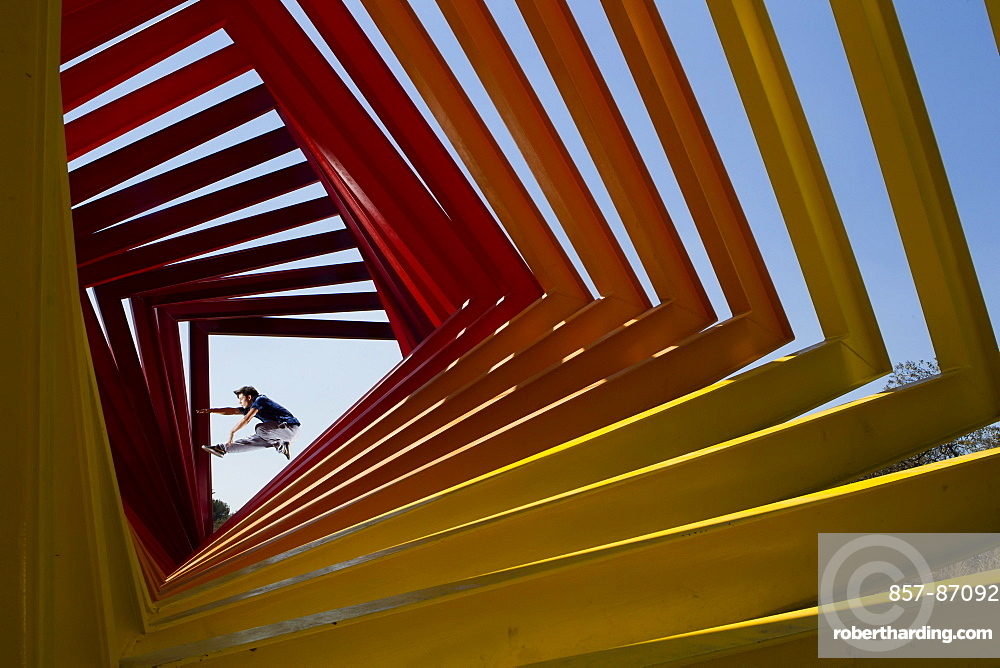 A young man performs different parkour jumps in several locations at the National University (UNAM), in Mexico City