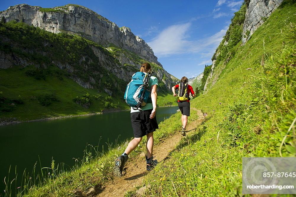 Julia Lohfink and Jochen Reiser hiking in the mountains of Appenzellerland, Switzerland.