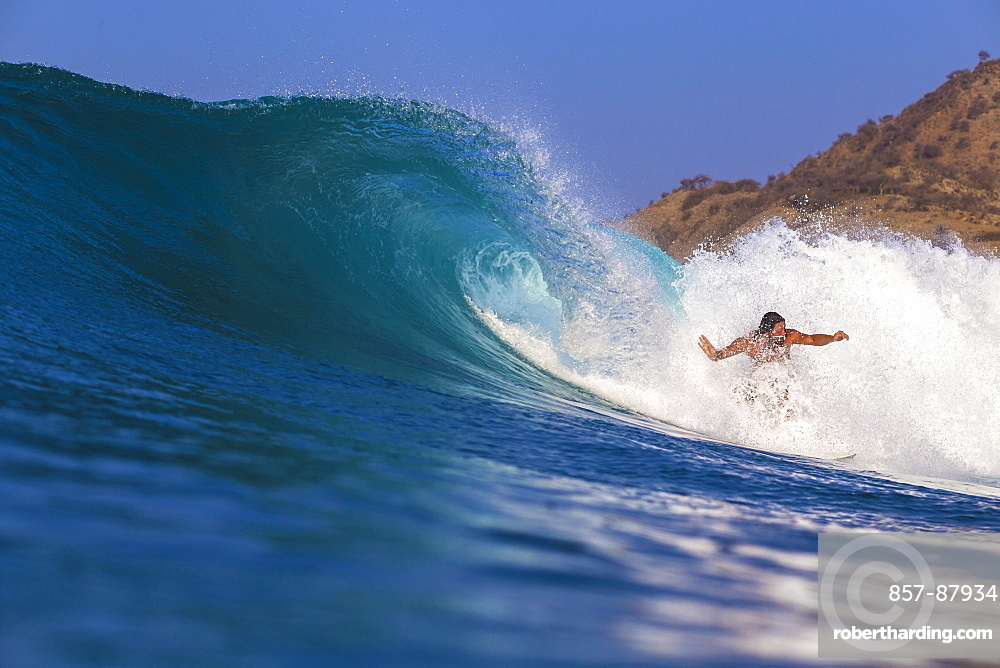 Surfer with a board in the water. West Sumbawa.Indonesia.Indonesia